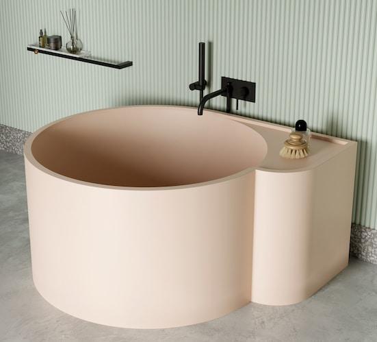 gros plan sur la baignoire ilot ronde rose poudré Nouveau Ext