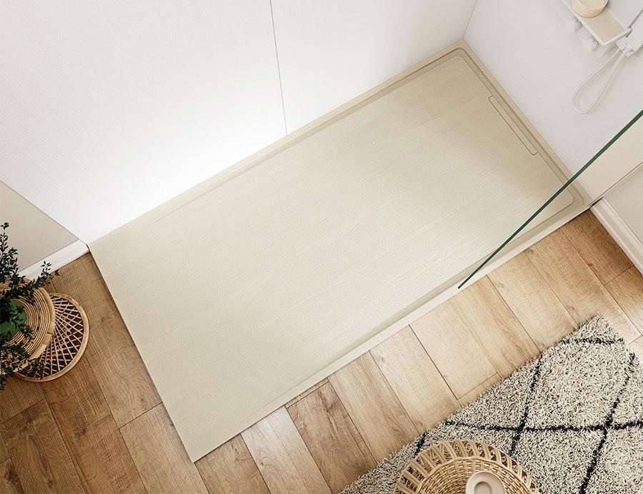 receveur de douche couleur sable sur parquet en bois