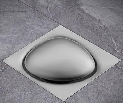 siphon de douche en forme de galet