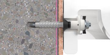 coupe d'un mur avec une cheville WST Klik de Fischer dans un mur